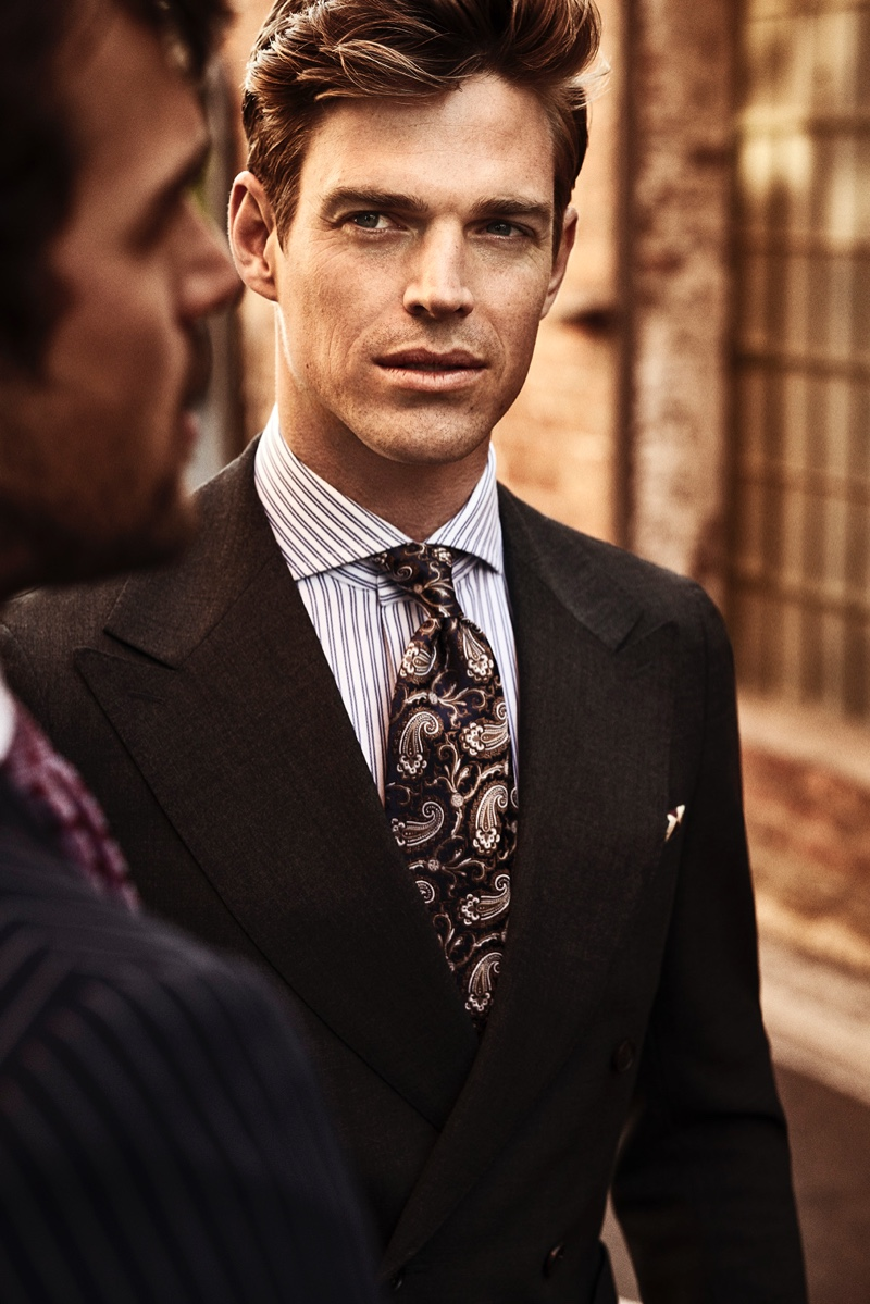 Zack Hartwanger dons a striped shirt with a paisley print tie by Eton.