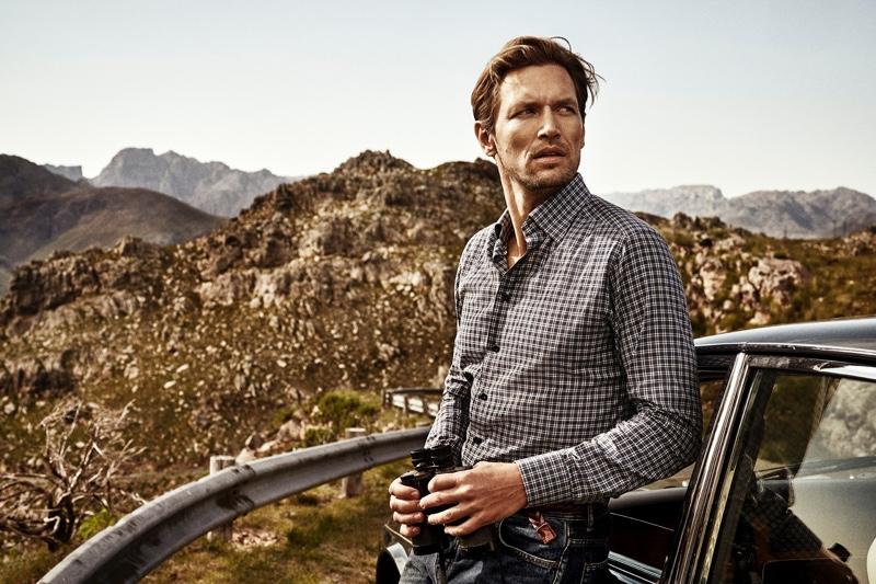 Venturing outdoors, Robertas Aukstuolis wears a shirt by Eton.