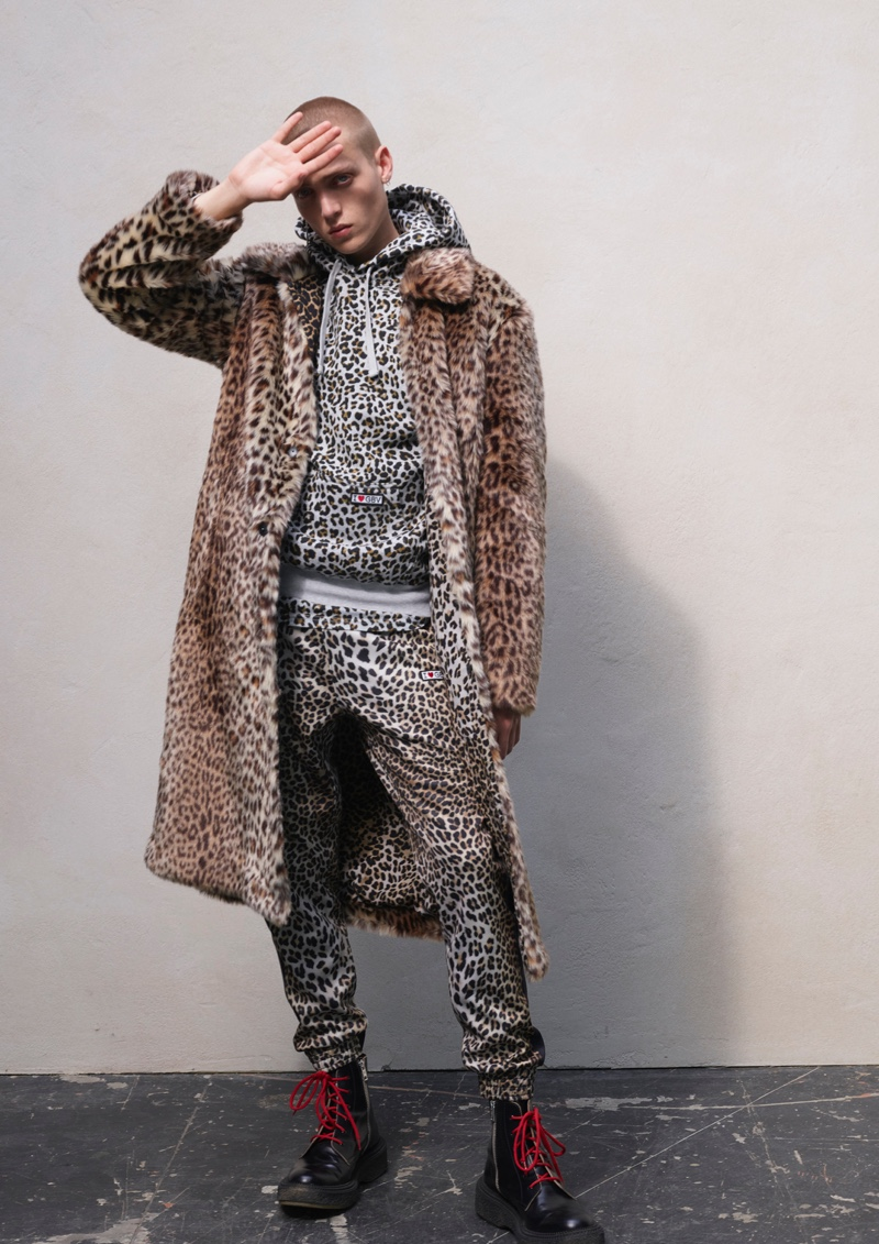 Making a case for animal prints, Tom Rey models a must-have look from the Giambattista Valli x H&M collection.