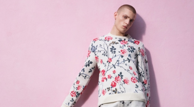 Tom Rey sports a floral print and bleach look from the Giambattista Valli x H&M collection.