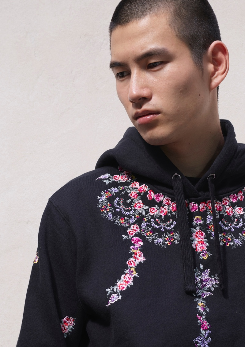 Kohei Takabatake and Oslo Grace embrace streetwear-influenced looks from the Giambattista Valli x H&M collection.