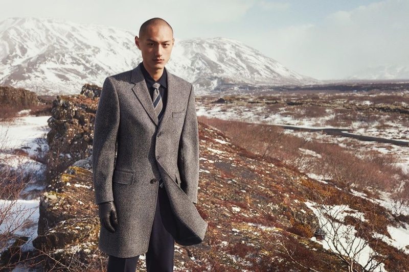 Donning a sleek gray coat,  Wei Qi fronts Gieves & Hawkes' fall-winter 2019 campaign.