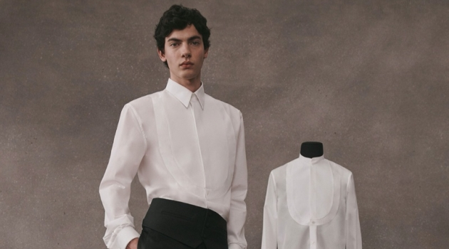 Lev Uliesov dons a sleek white and black tailored look from the Givenchy Atelier collection.