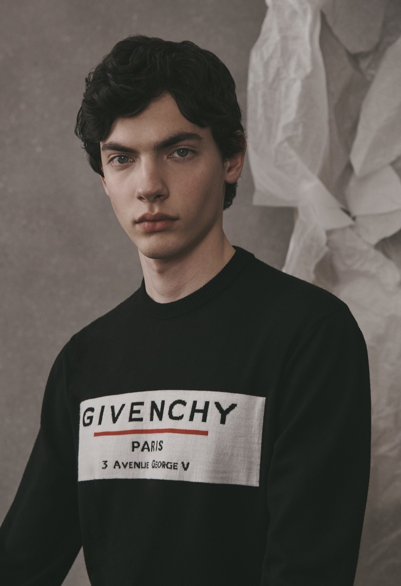 Front and center, Lev Uliesov sports a logo sweater from the Givenchy Atelier collection.
