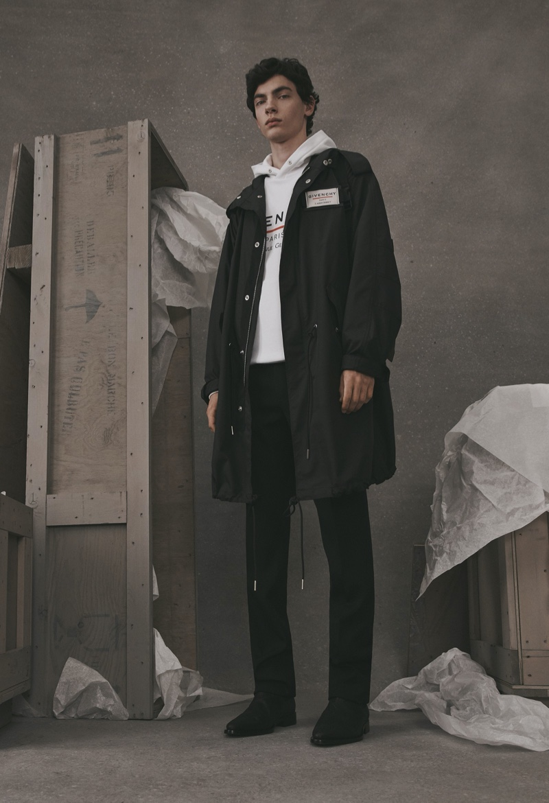 Going casual, Lev Uliesov dons a parka and hoodie from the Givenchy Atelier collection.