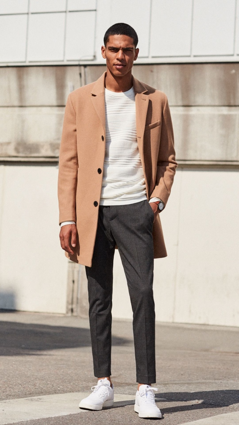 Front and center, Geron McKinley sports a camel coat with gray trousers from H&M.