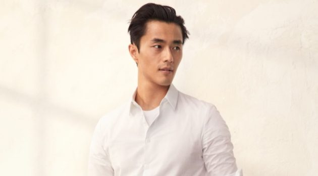 Zhao Lei sports a smart pair of black trousers with a white dress shirt by H&M.