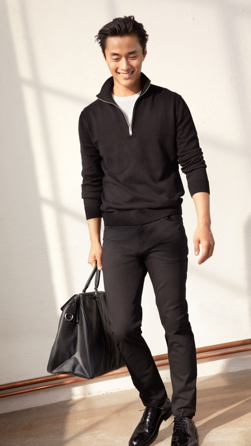 Going sporty, Zhao Lei models a pair of black pants with a half-zip pullover by H&M.