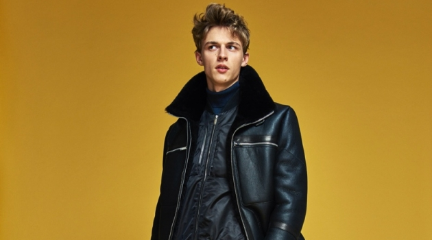 Front and center, Max Barczak dons a sleek black look from Karl Lagerfeld's fall-winter 2019 collection.