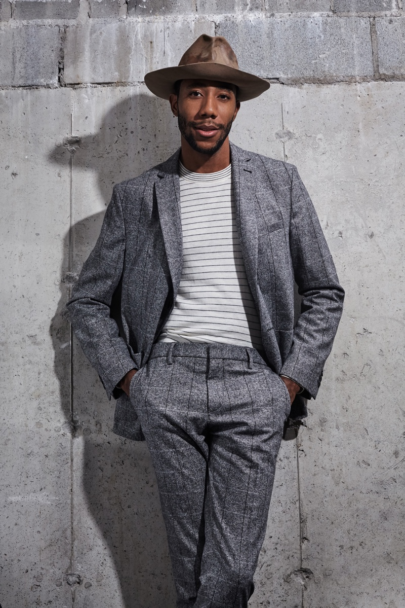 Linking up with Ben Sherman, La Touché dons a sharp windowpane suit in grey with a striped top.