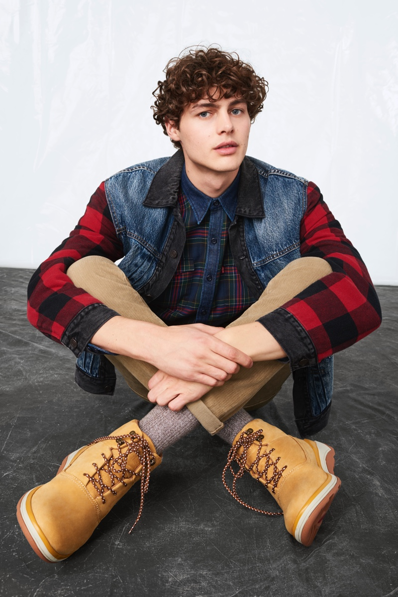 Darwin Gray sports a denim and buffalo check jacket with a plaid shirt from Levi's fall-winter 2019 collection.