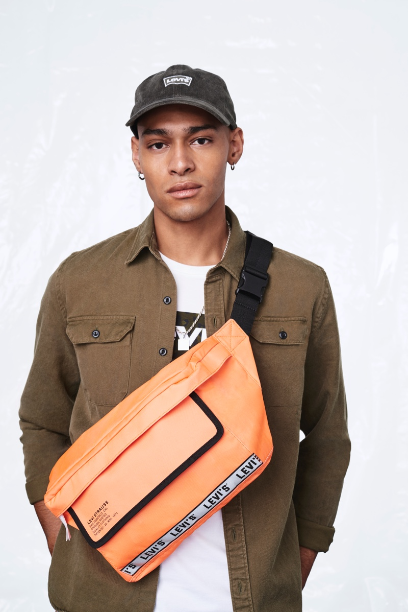 Front and center, Sua El Gagui brings attention to one of Levi's bold and colorful belt bags for the season.