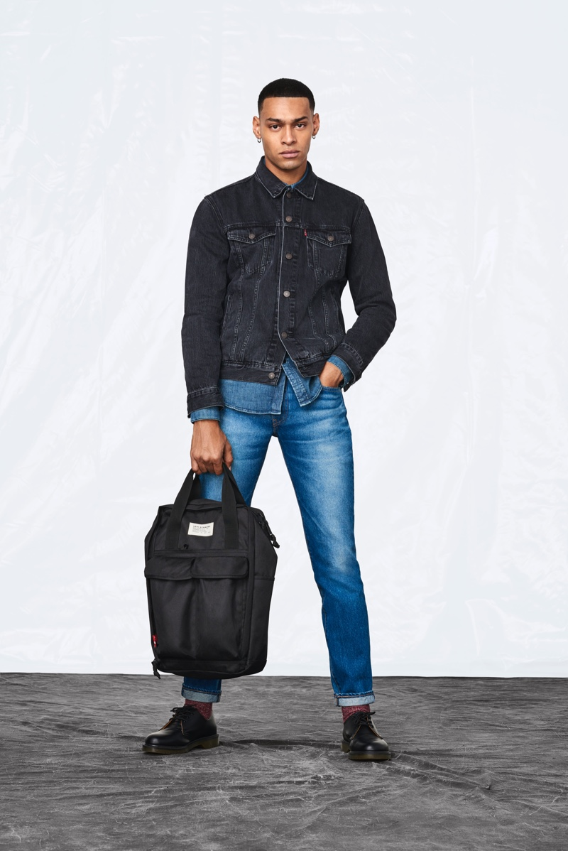 Holding one of Levi's new backpacks, Sua El Gagui doubles down on classic denim from the brand.