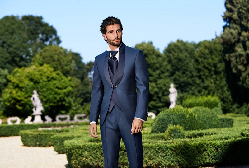 Donning a navy vest and tuxedo, Andrea Melchiorre wears Lubiam 1911 Cerimonia.