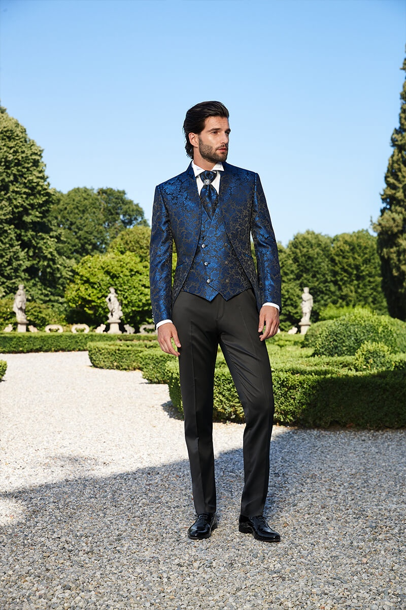 Embracing a dandy flair, Andrea Melchiorre dons a brocade print waistcoat and dinner jacket by Lubiam 1911 Cerimonia.
