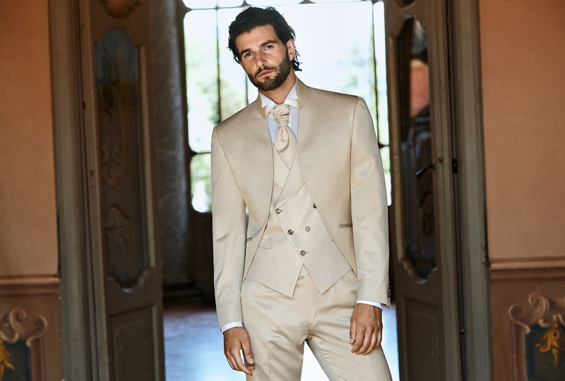 Standing out in a soft neutrals, Andrea Melchiorre charms in a dapper three-piece suit from Lubiam 1911 Cerimonia.