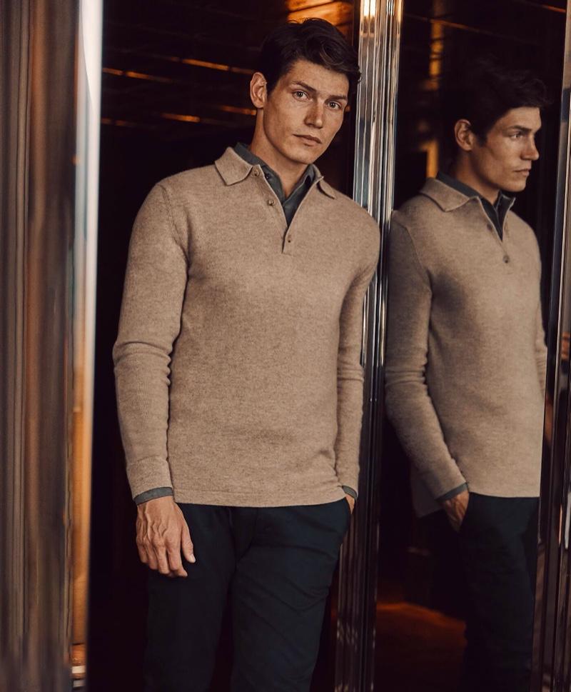 A smart vision, Sam Way wears Luca Faloni's camel beige cashmere polo sweater.