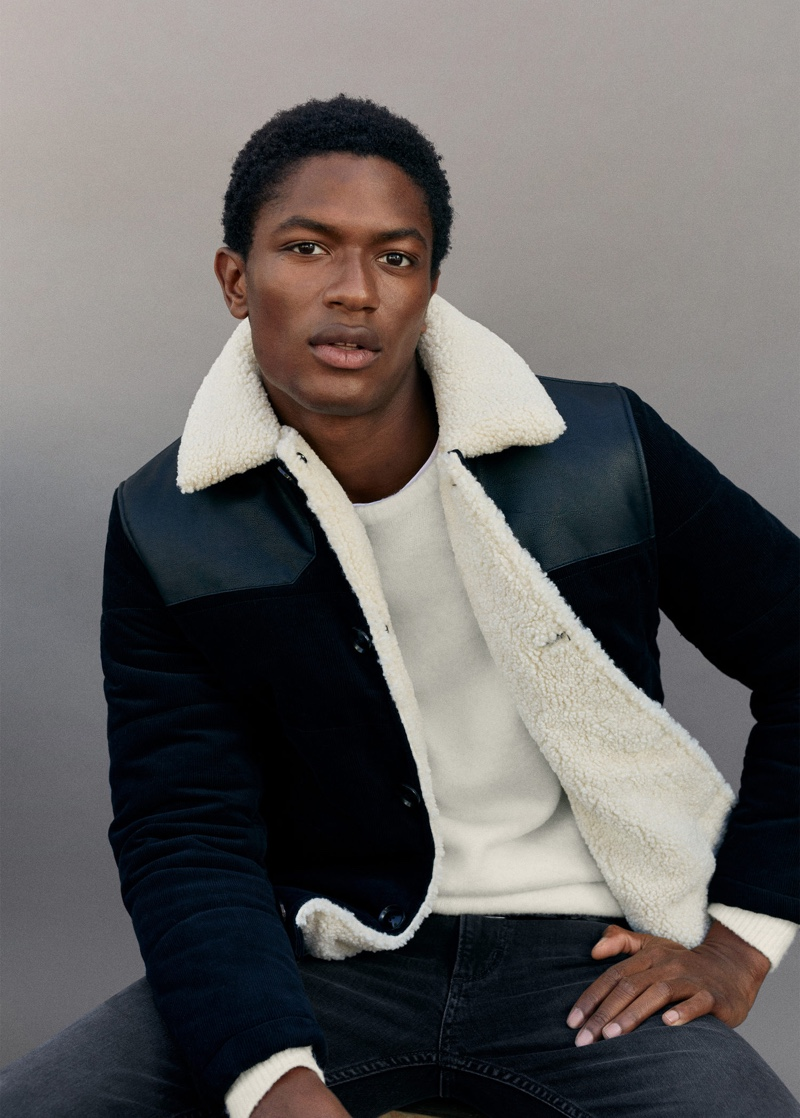 Hamid Onifade sports a corduroy jacket with dark wash jeans from Mango.