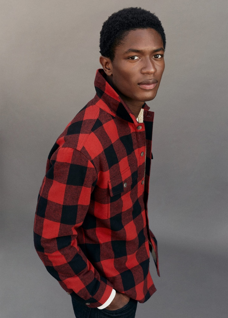 Making a case for black and red, Hamid Onifade wears a classic buffalo check overshirt.