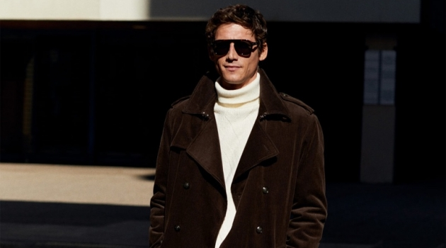Roch Barbot dons a brown corduroy trench coat with a turtleneck sweater and trousers from Mango.
