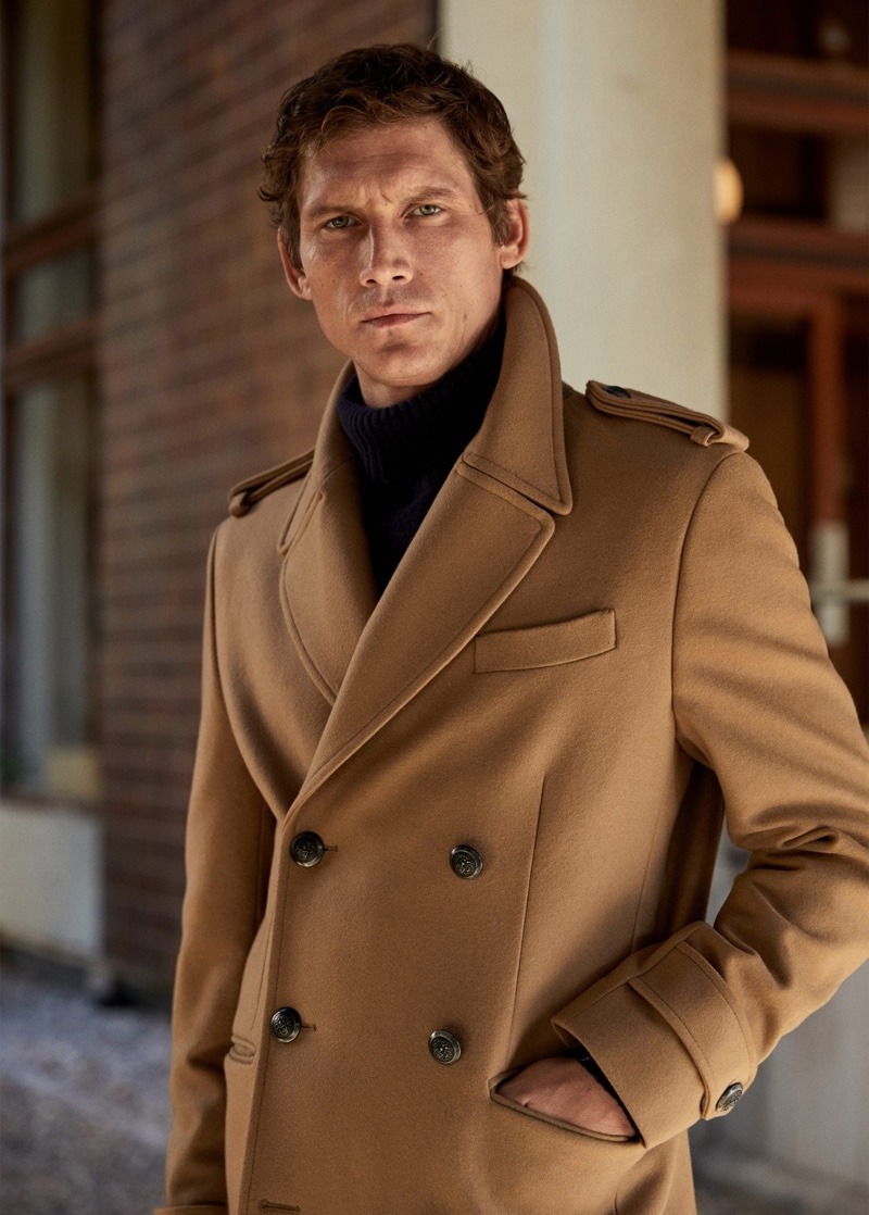 A chic vision, Roch Barbot sports a double-breasted camel coat from Mango.