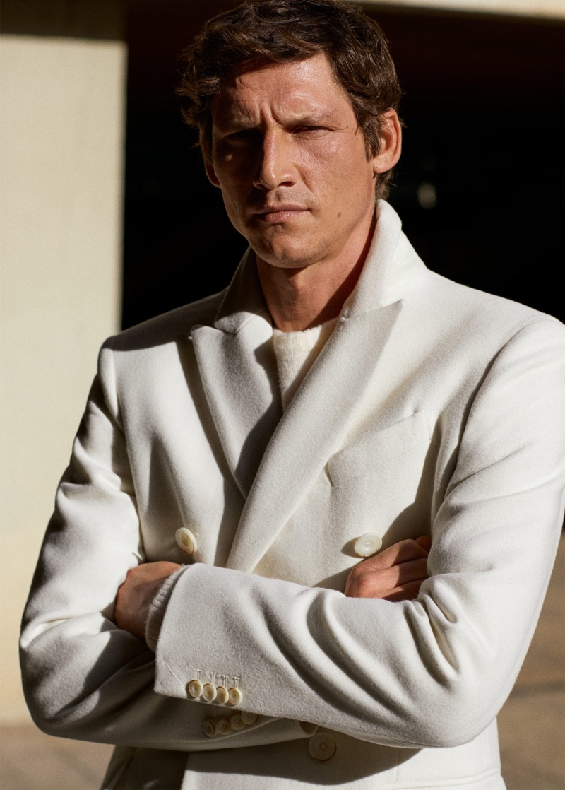 Making a case for neutrals, Roch Barbot dons an off-white coat by Mango.