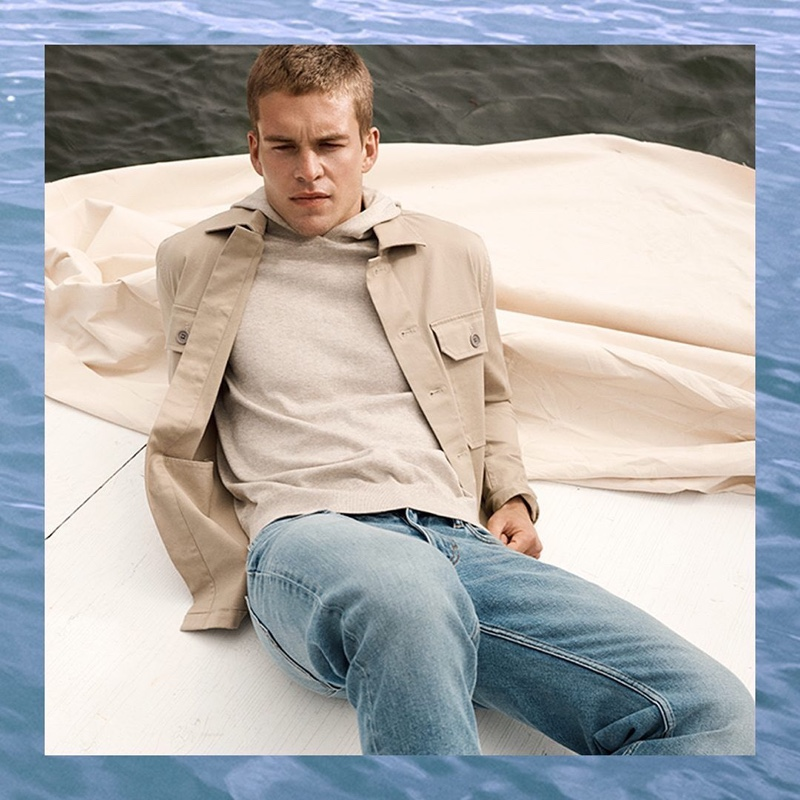 Mitchell Slaggert dons a khaki jacket and hoodie with jeans from Banana Republic.