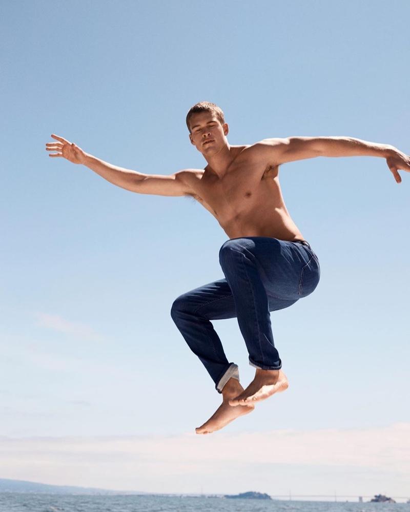 Rocking denim jeans, a shirtless Mitchell Slaggert wears Banana Republic.