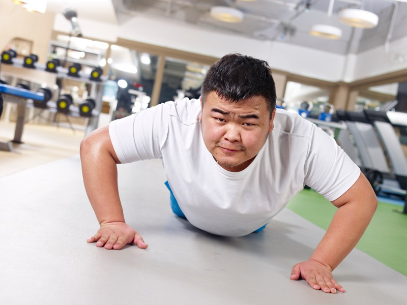 Overweight Man Pushups Exercise