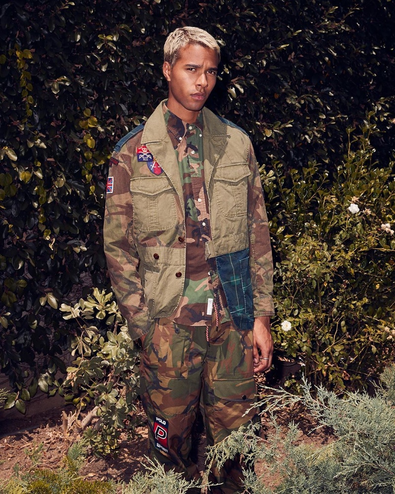 Embracing camouflage prints, Daouda Ka wears a POLO Ralph Lauren oxford shirt $98, hybrid jacket $498, and pants $188.
