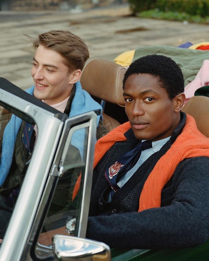 Cruising in a vintage car, Angus Eaton and Hamid Onifade wear POLO Ralph Lauren.