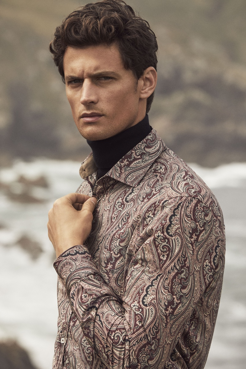 Connecting with Pedro del Hierro for its winter 2019 campaign, Garrett Neff sports a paisley print shirt.