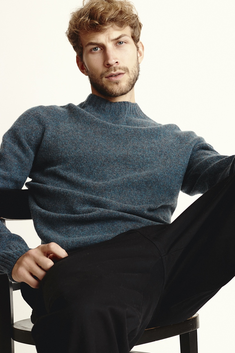 Rasmus wears sweater and pants UNIQLO U.
