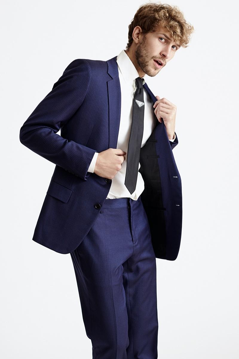 Rasmus wears shirt Tom Ford, tie Prada, and suit Dior.