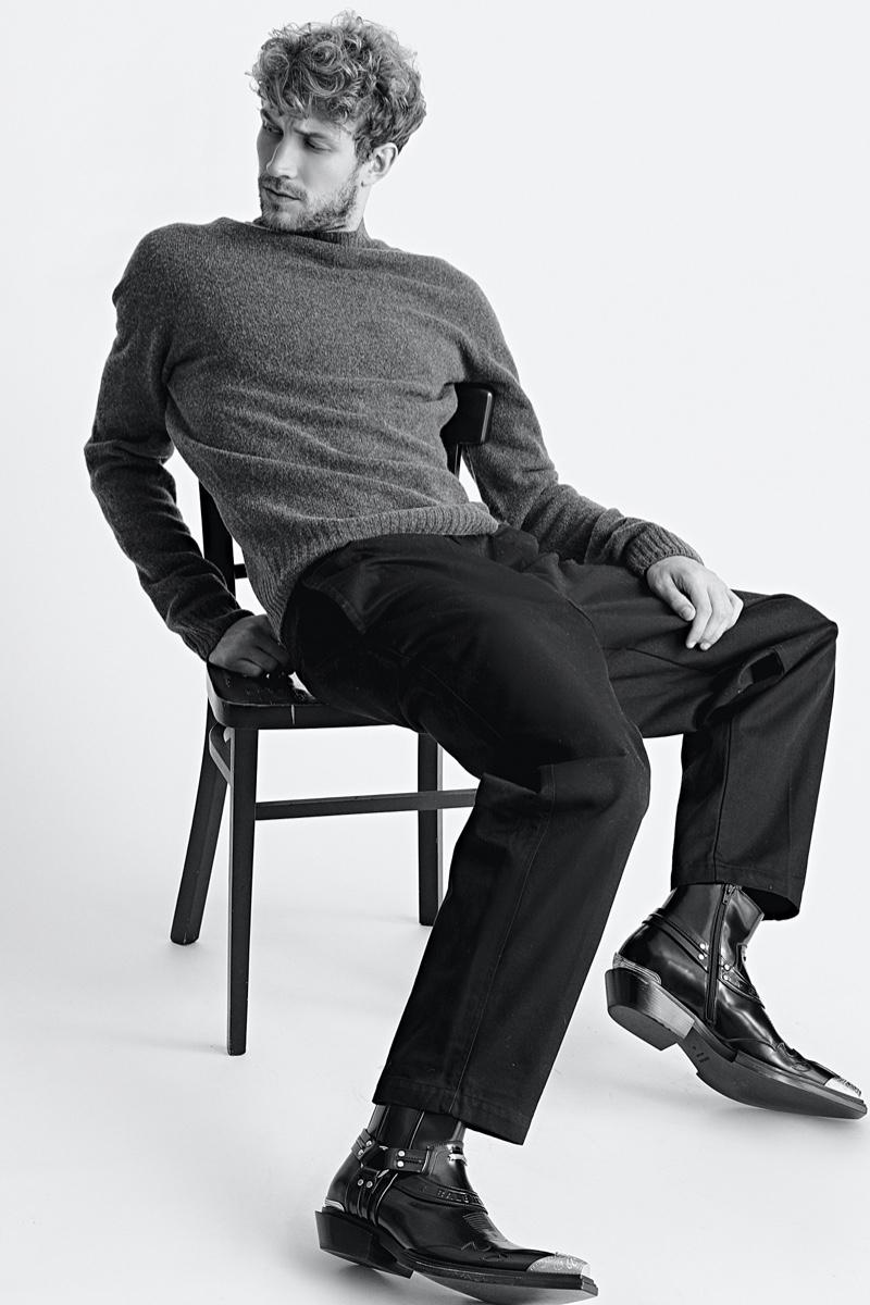 Rasmus wears boots Balenciaga, sweater and pants UNIQLO U.