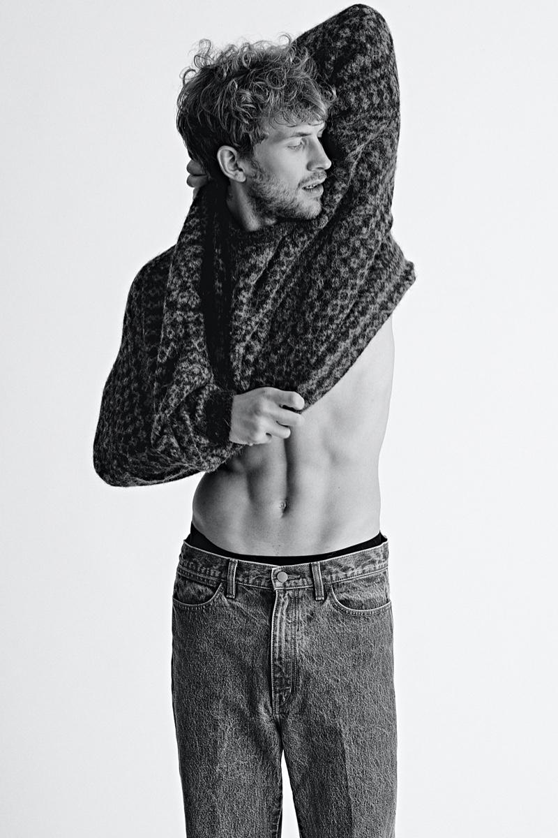 Rasmus wears sweater American Vintage and jeans UNIQLO U.