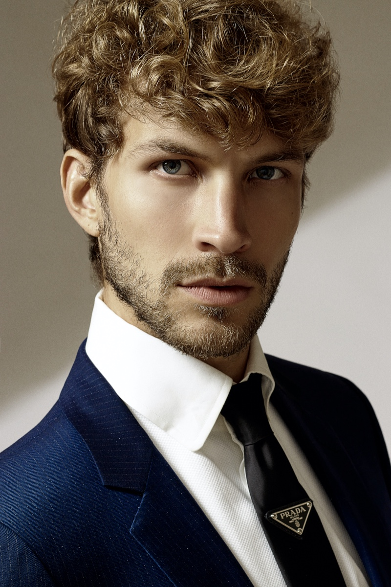Rasmus wears shirt Tom Ford, tie Prada, and suit jacket Dior.