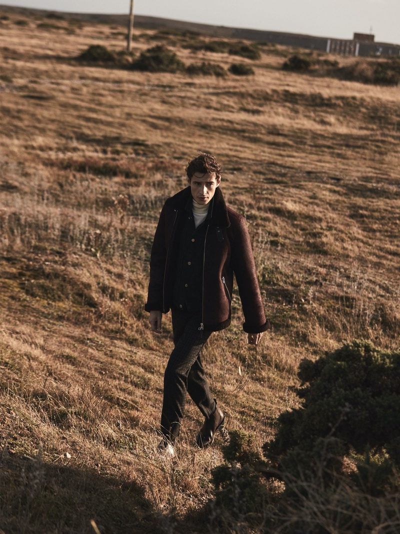 Stepping out, Adrien Sahores dons Reiss' Rogan coat in brown.