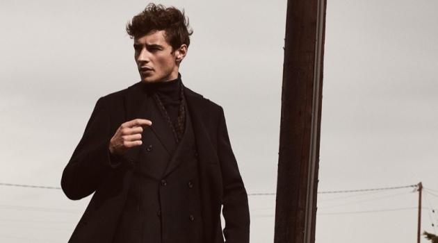 French model Adrien Sahores sports Reiss' Gable wool epsom overcoat $545 in navy.