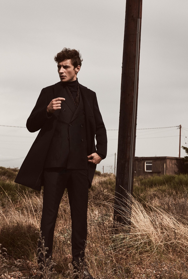 French model Adrien Sahores sports Reiss' Gable wool epsom overcoat $545 in navy.