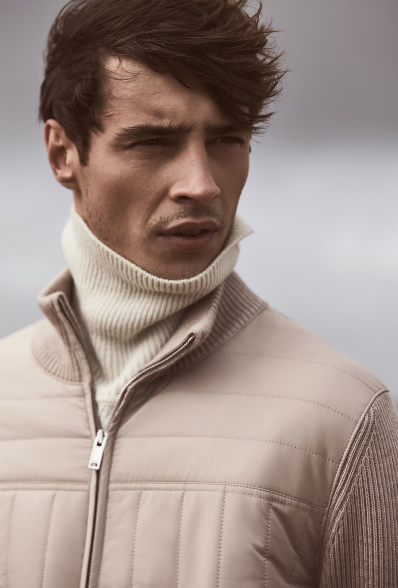 Connecting with Reiss, Adrien Sahores wears the brand's Quentin quilted zip through jacket $285 in oatmeal.