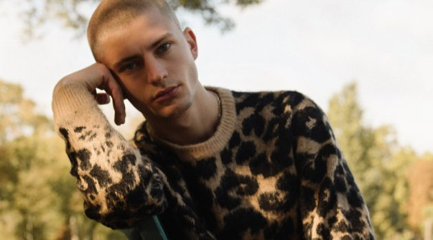 Lucas Berny sports a leopard print sweater from Reserved.