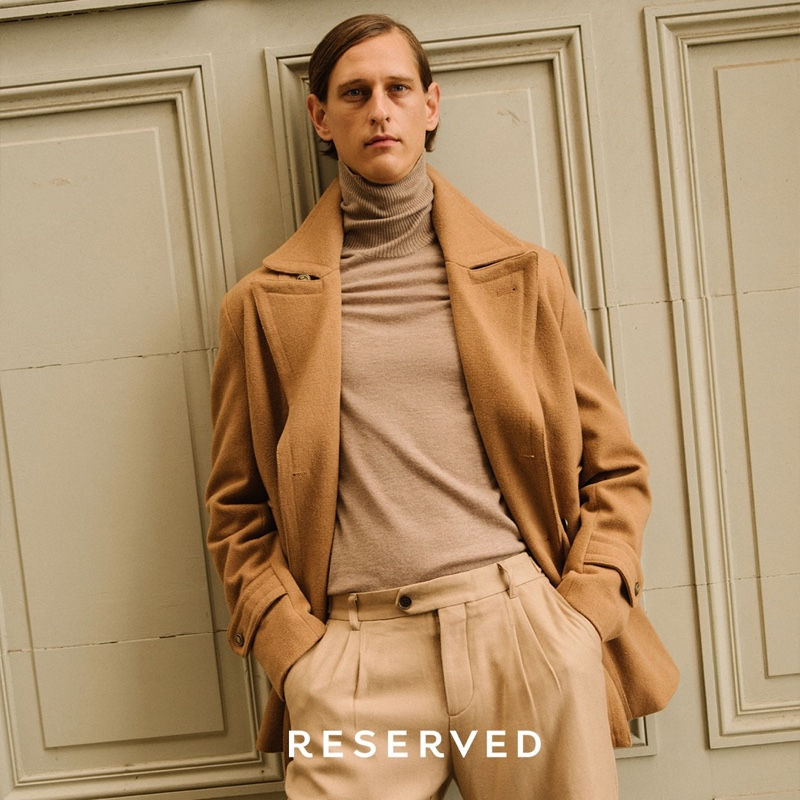 Making a case for monochromatic style, Rogier Bosschaart models a camel coat by Reserved.