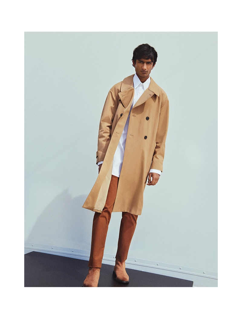 Embracing neutrals, Rishi Robin wears a Burberry trench coat with Maison Margiela pants.