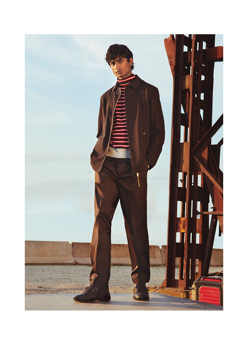 Rishi Robin stands by graphic style in a striped Marni turtleneck sweater with Calvin Klein pants.