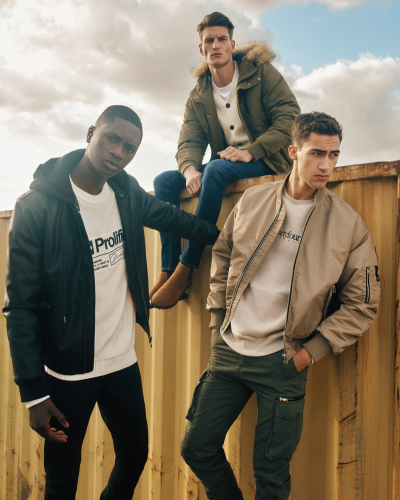 Models Junior Choi, John Todd, and Alessio Pozzi wear fall-winter 2019 outerwear from River Island.