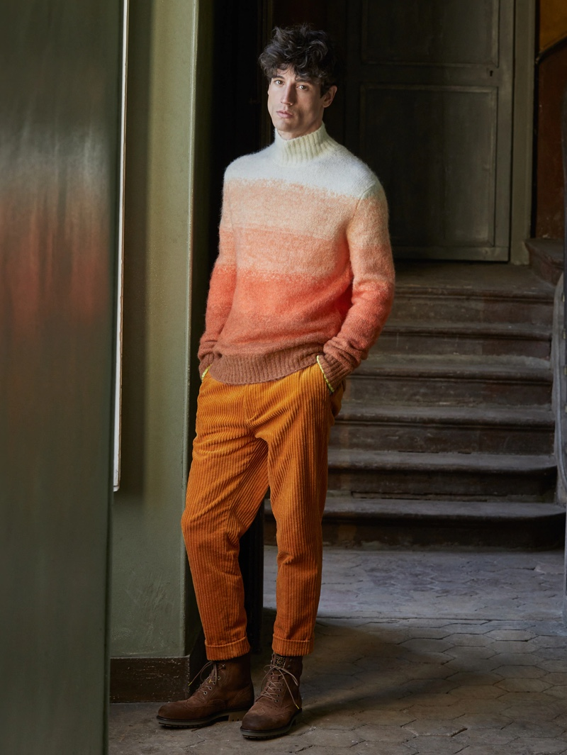 Making a case for orange, Nicolas Ripoll wears a Scotch & Soda gradient knit turtleneck $195 with corduroy trousers $165.