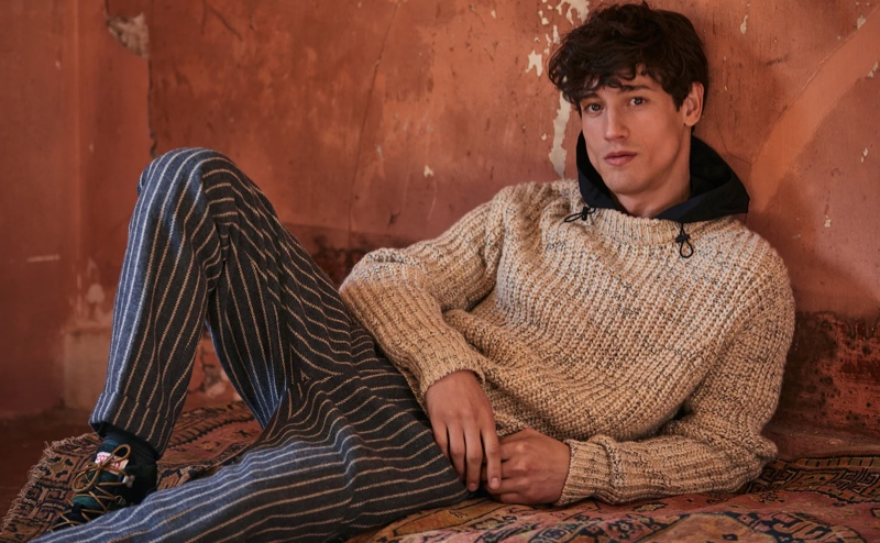 A chic vision, Nicolas Ripoll sports a Scotch & Soda hooded sweater $198 and wool blend trousers $165.