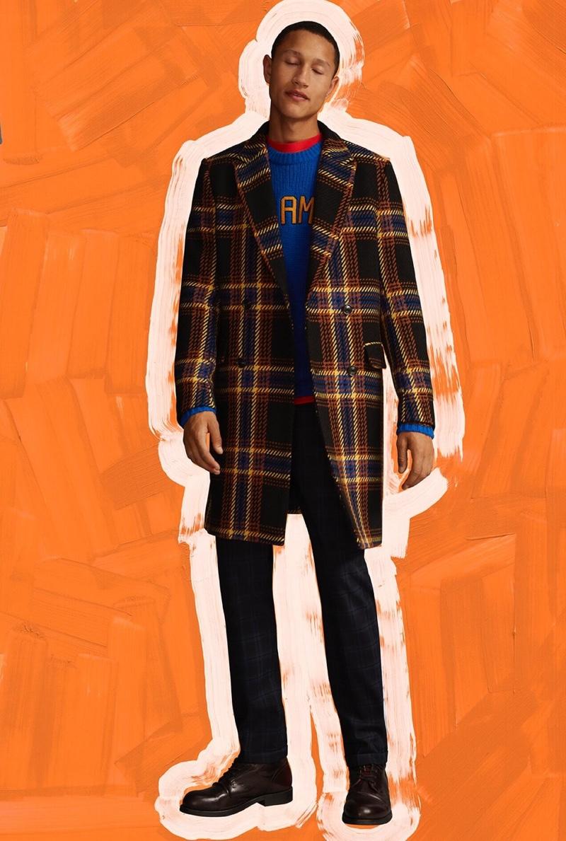 A sleek fall vision, Bruno Sitton wears a Scotch & Soda checked coat $395.