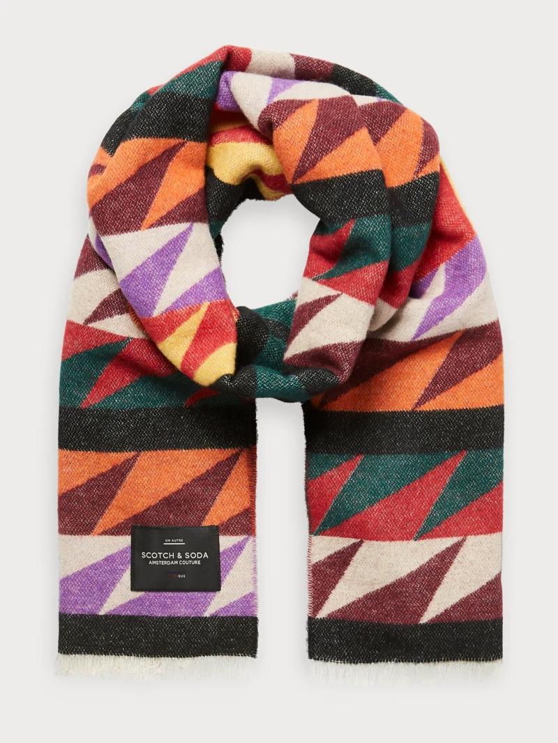 Peruvian influences shine through in this alpaca sweater and bold print geometric scarf.